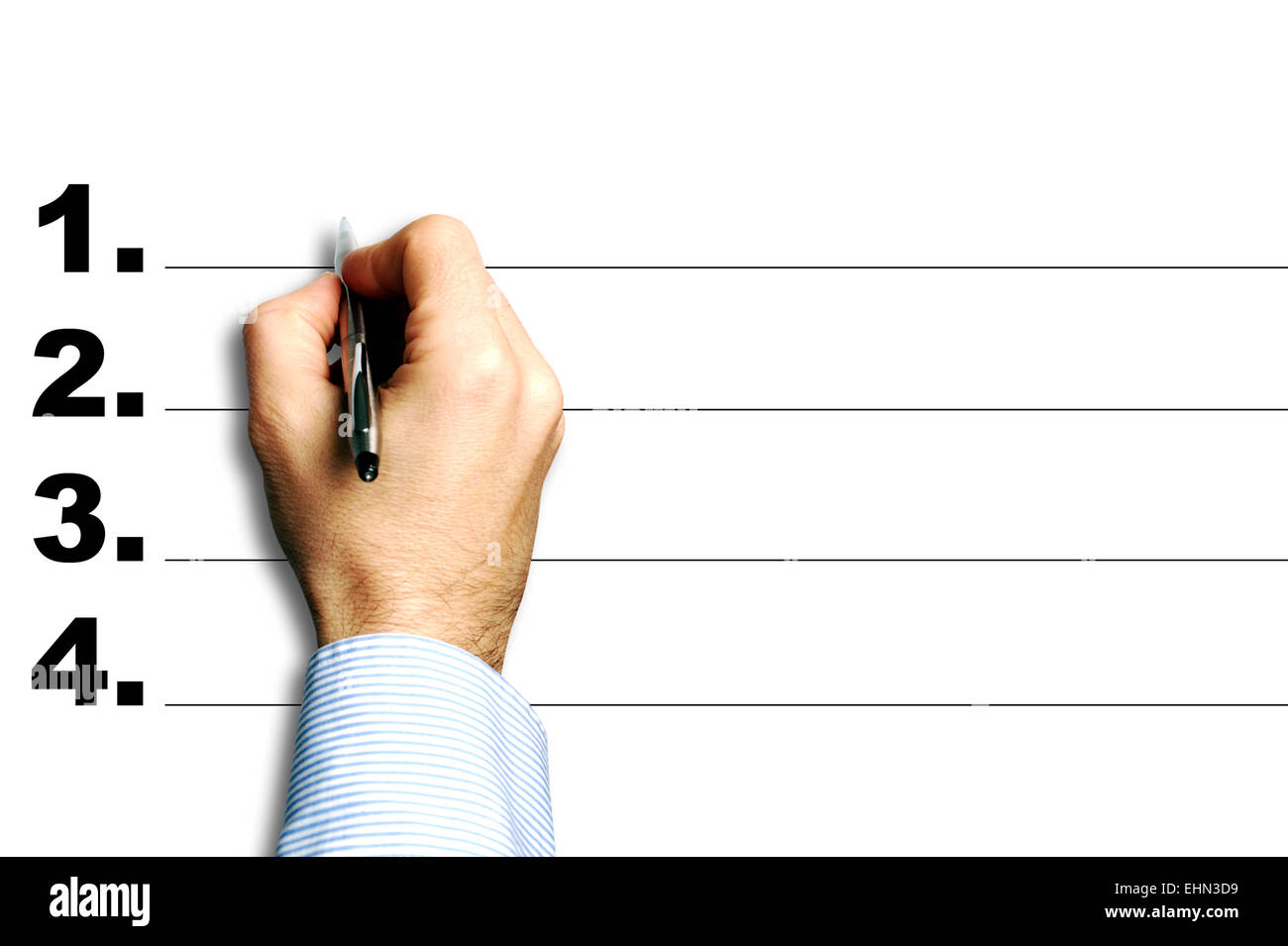 hand in process of writing notes on a numbered list - Stock Image