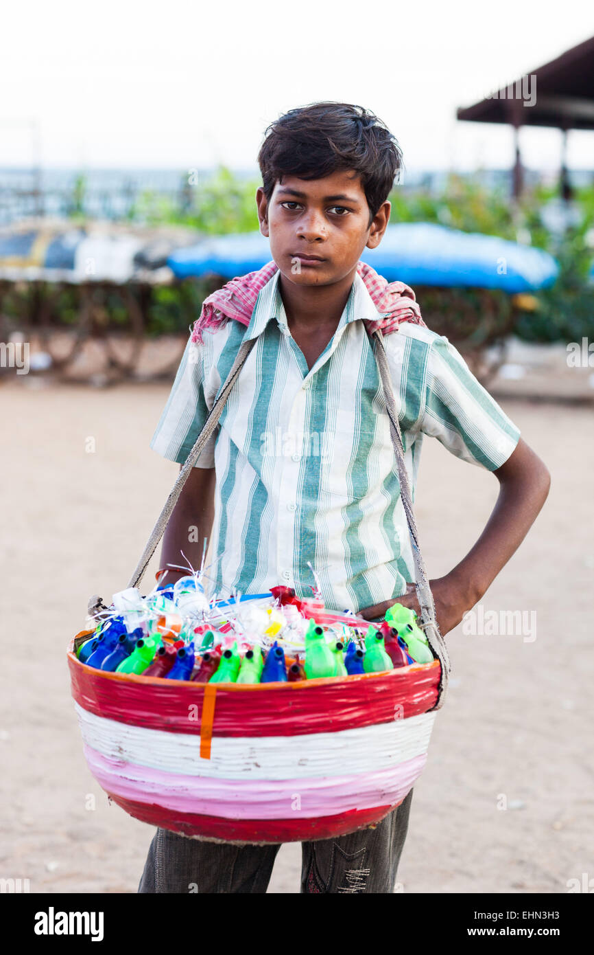 Young street vendors on the beach in Pondicherry, India. - Stock Image