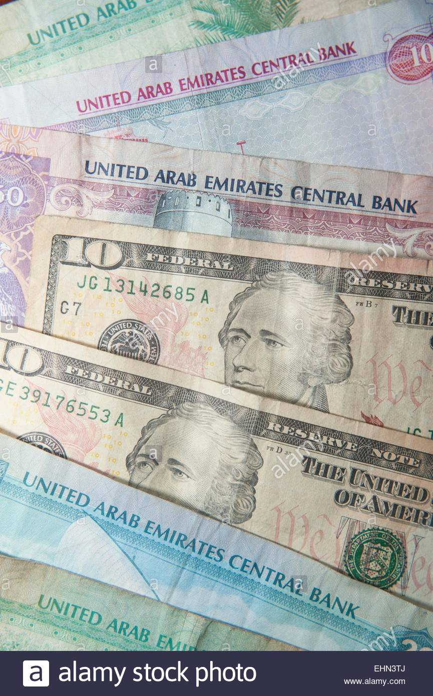 UAE dirhams and US dollars - Stock Image