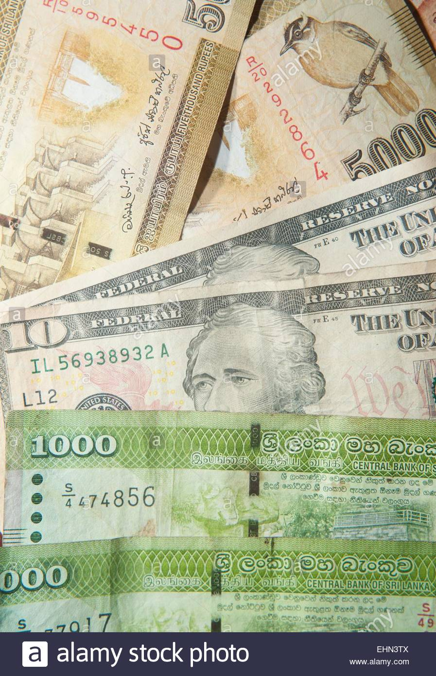Sri Lankan rupee and US dollars - Stock Image