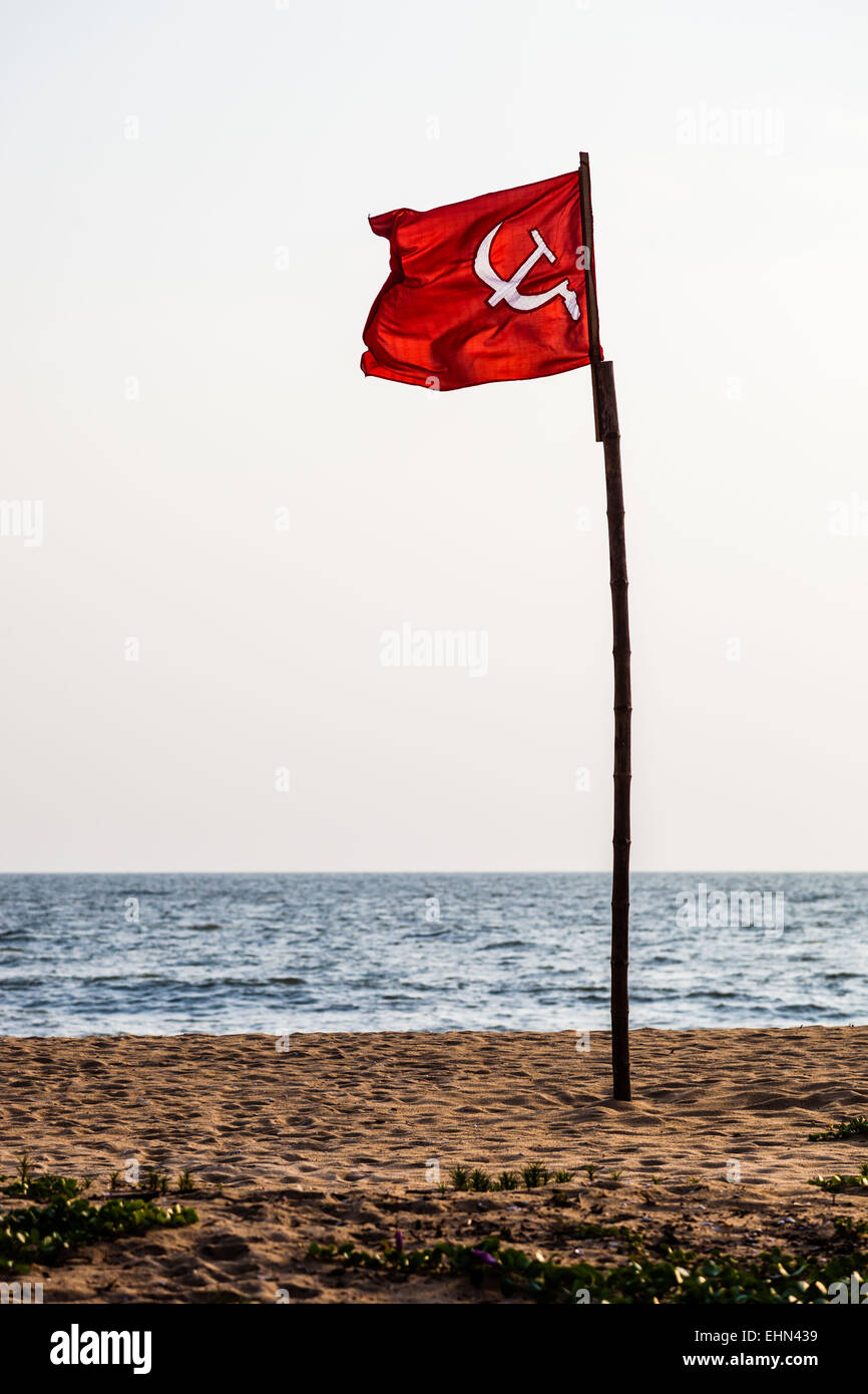 Communist flag on a beach in Kerala, India. - Stock Image