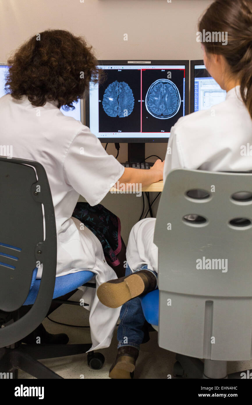Doctors studies CT and MRI scans of a stroke victim, Bordeaux hospital, France. - Stock Image