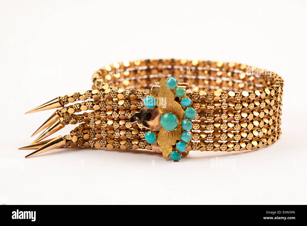 A 1950s fancy mesh link cuff gold bracelet with turquoise set clasp. - Stock Image