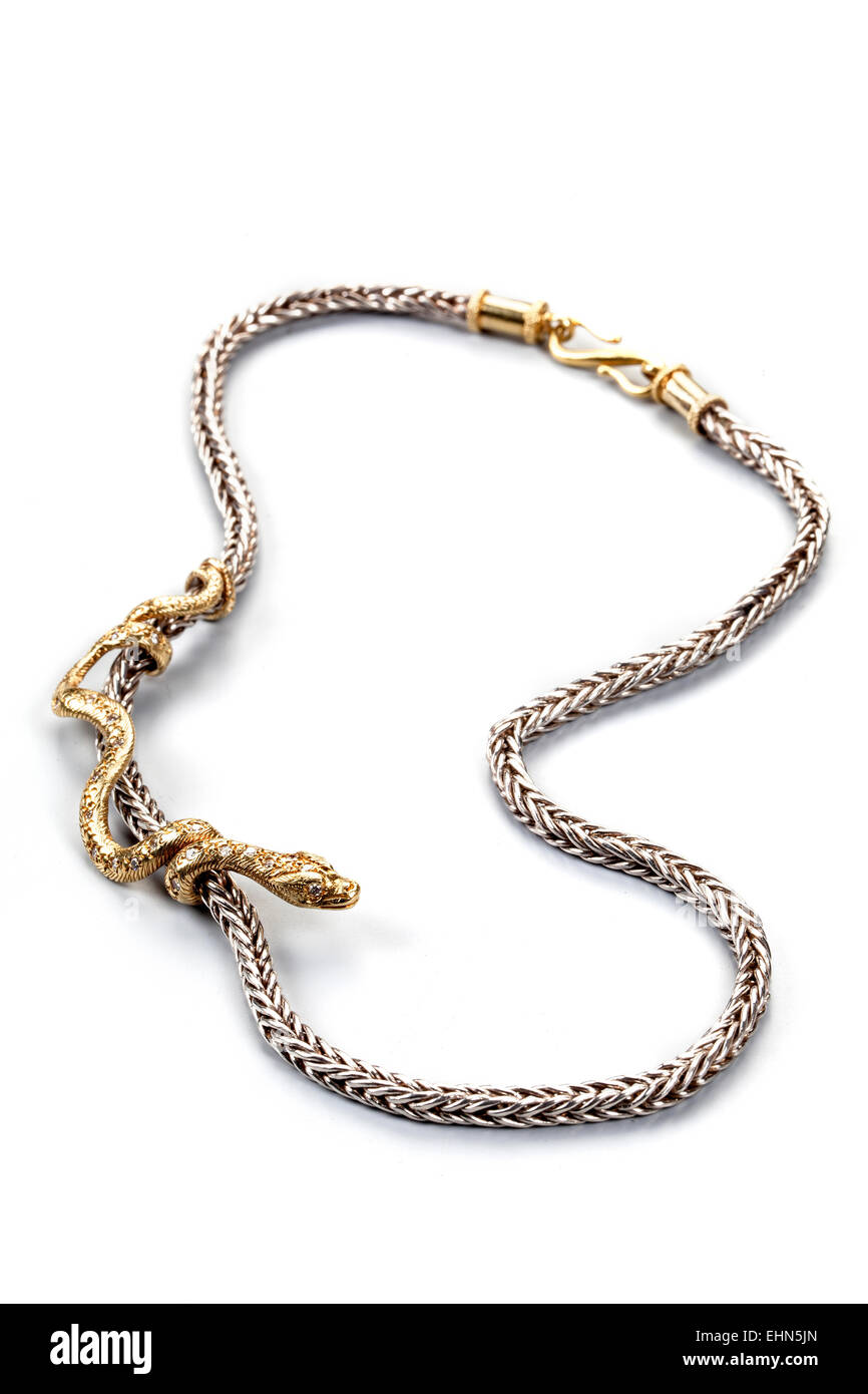 A bi-coloured necklace with diamond set sliding snake. - Stock Image