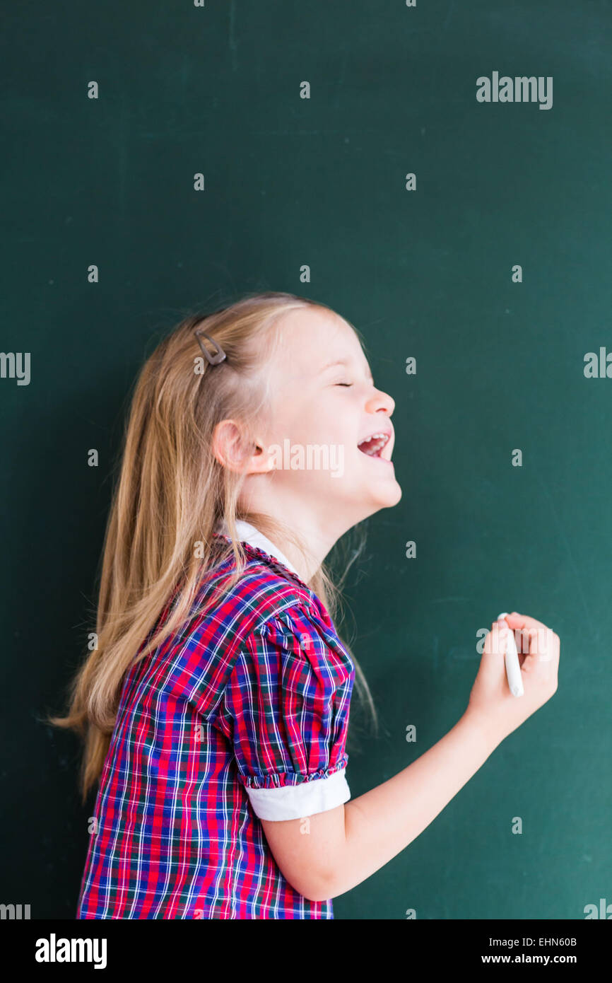 4 year old girl at school. - Stock Image
