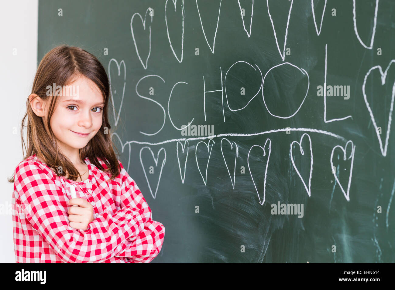 7 year old girl at school. - Stock Image