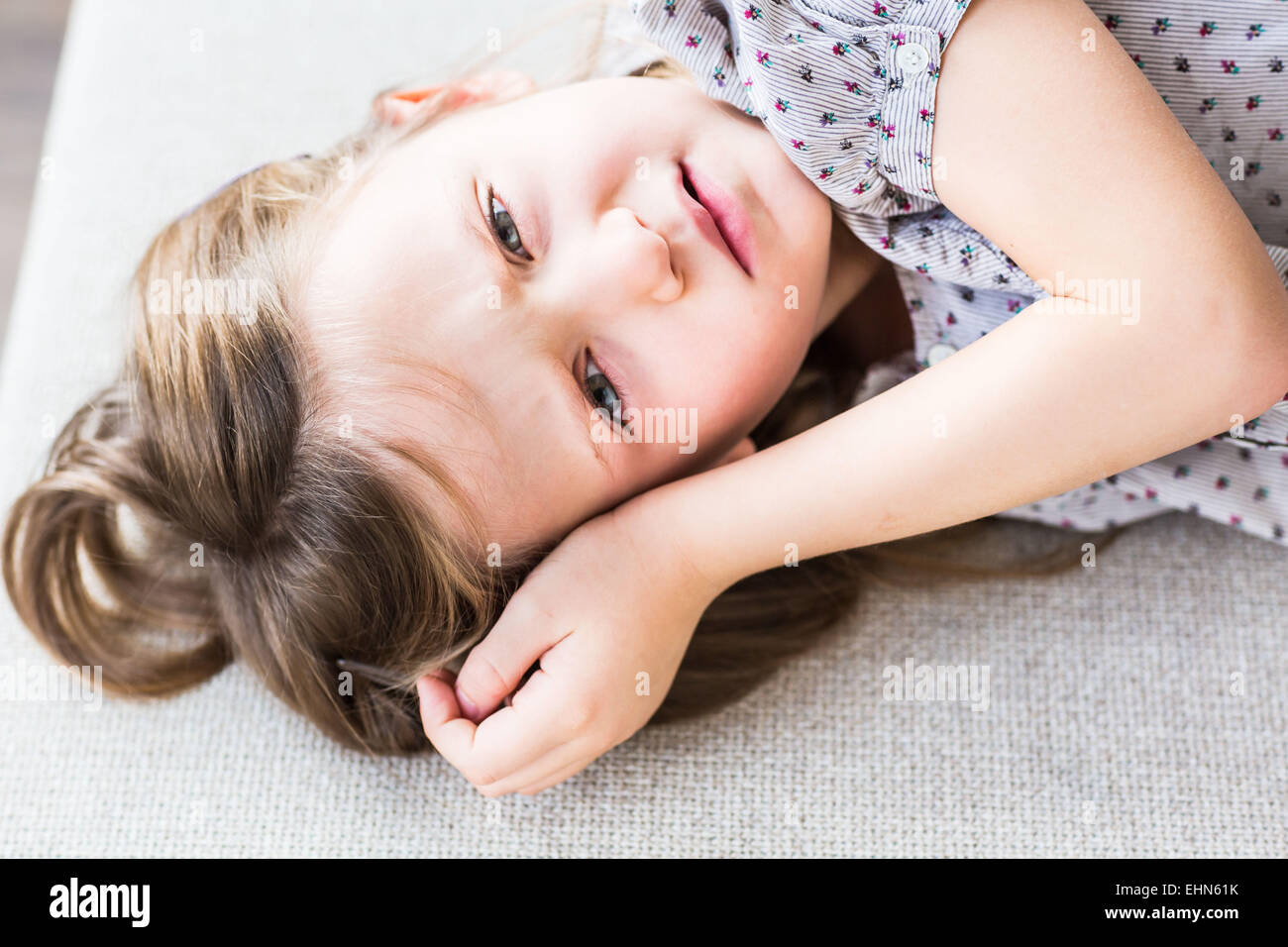 5-year-old girl looking sick and feverish. - Stock Image