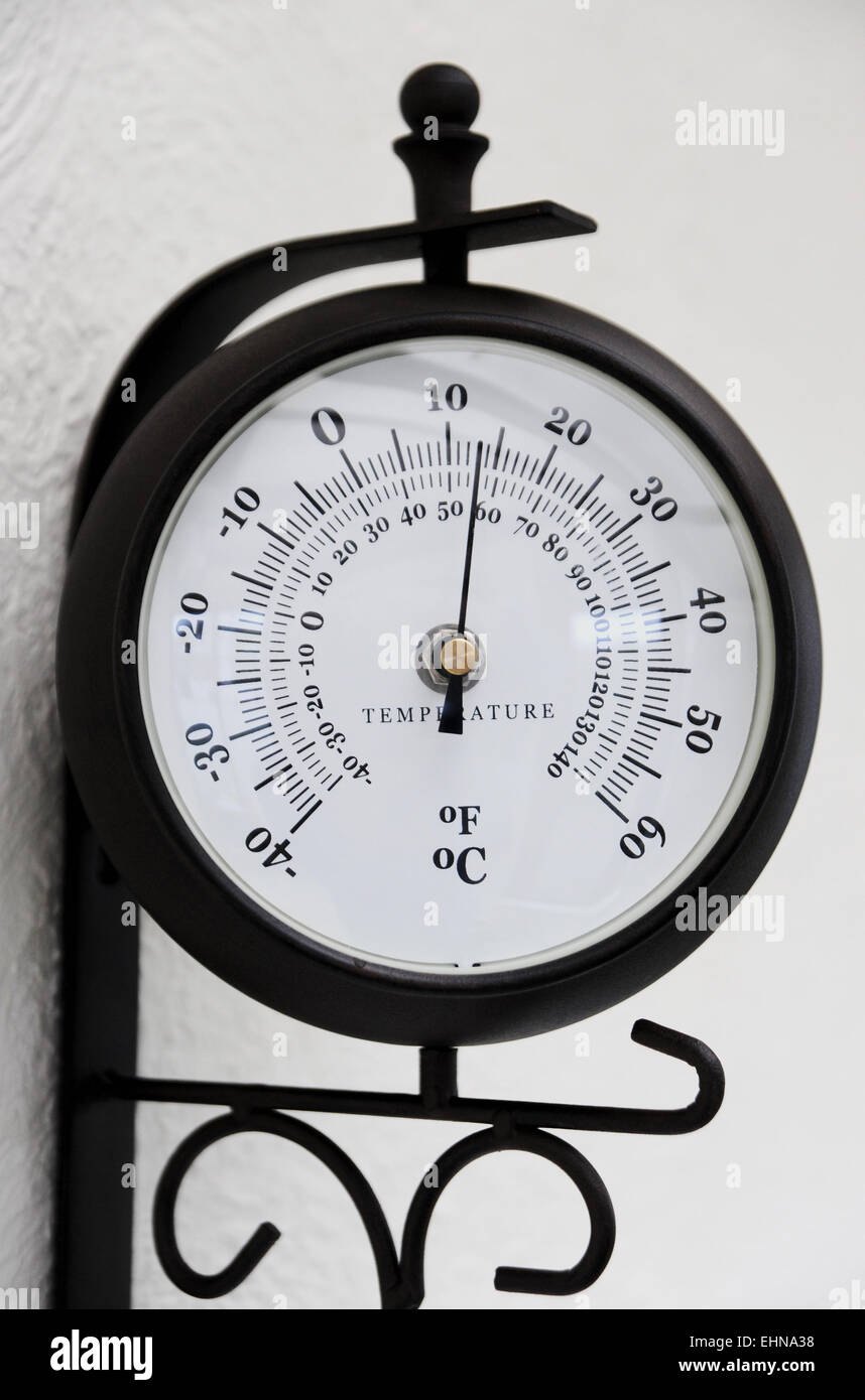 Air temperature guage hanging on wall - Stock Image