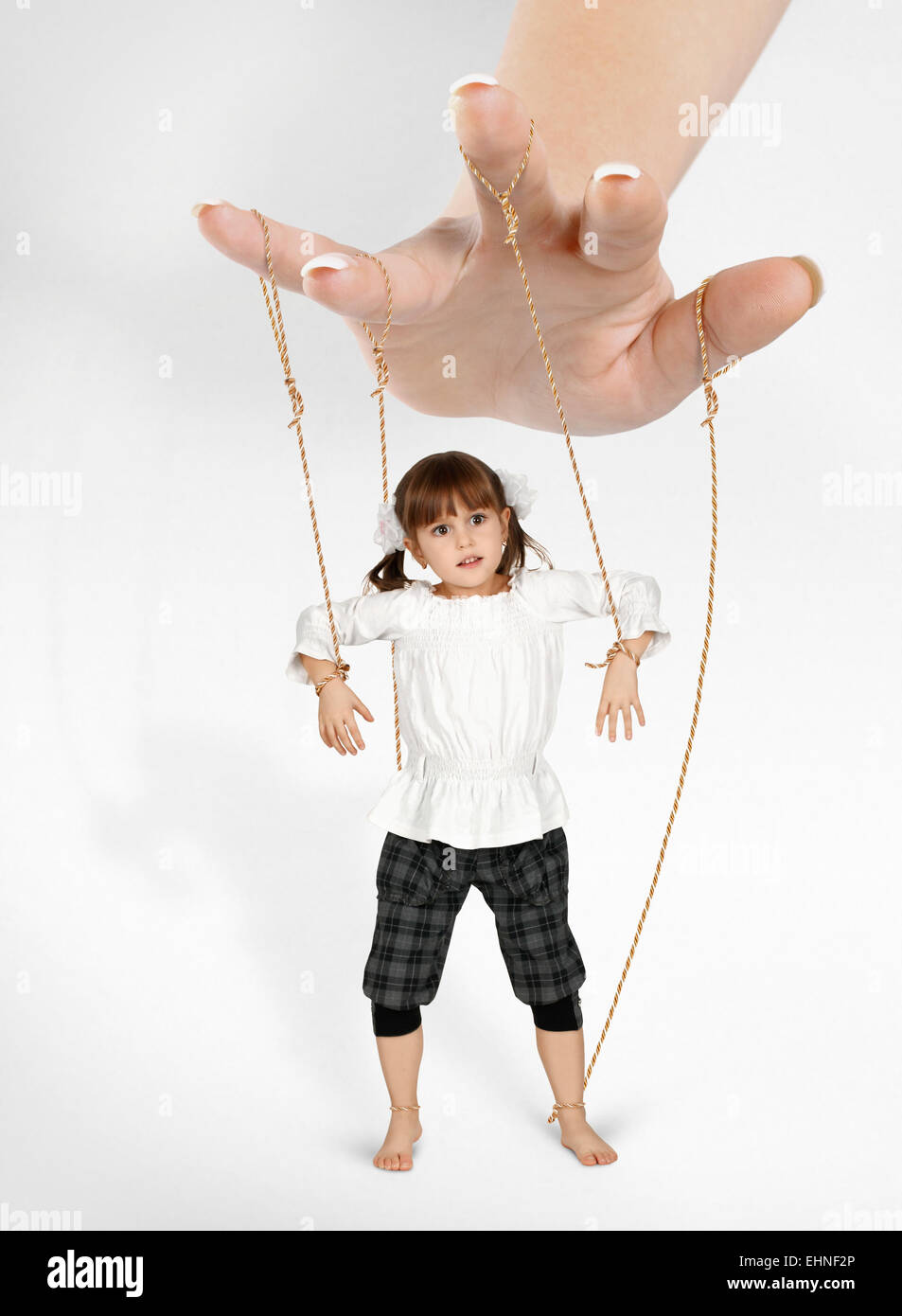 child girl - puppet , dependence concept - Stock Image