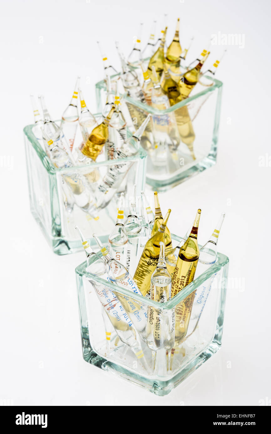 Glass ampoules of various trace elements. - Stock Image