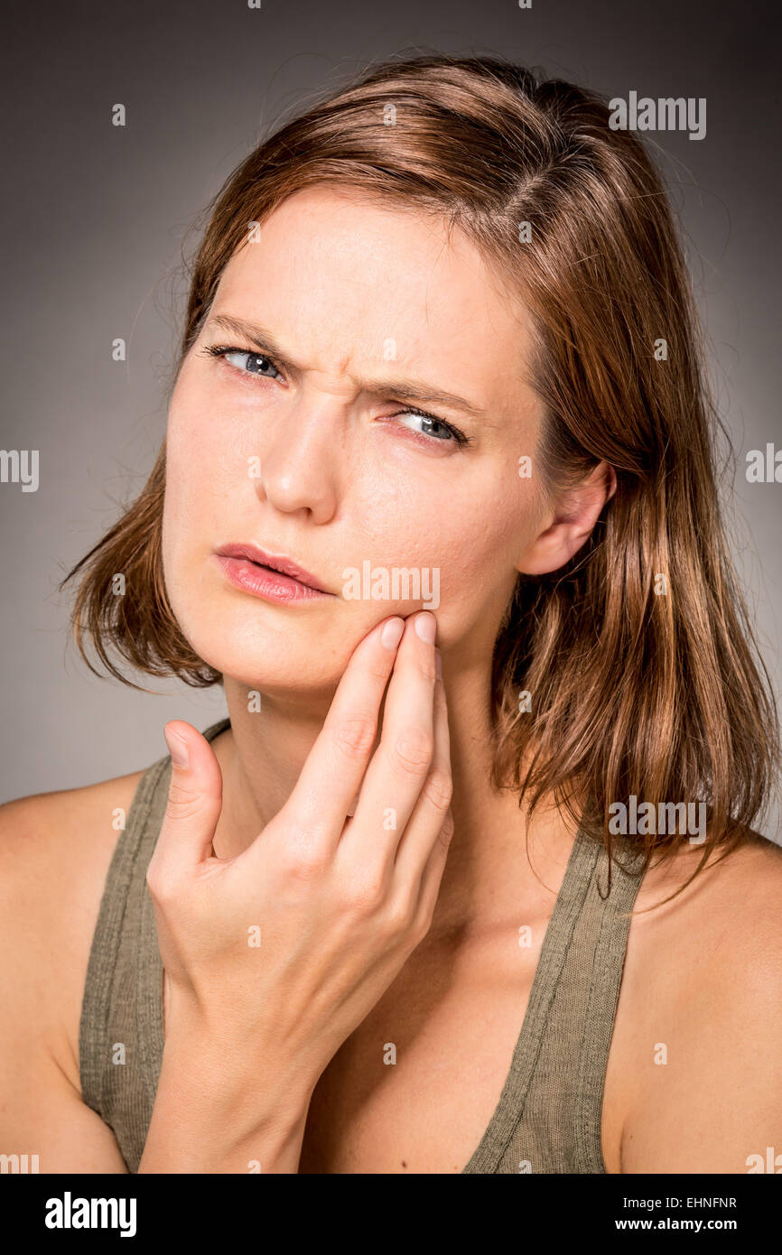 Woman suffering from toothache. - Stock Image