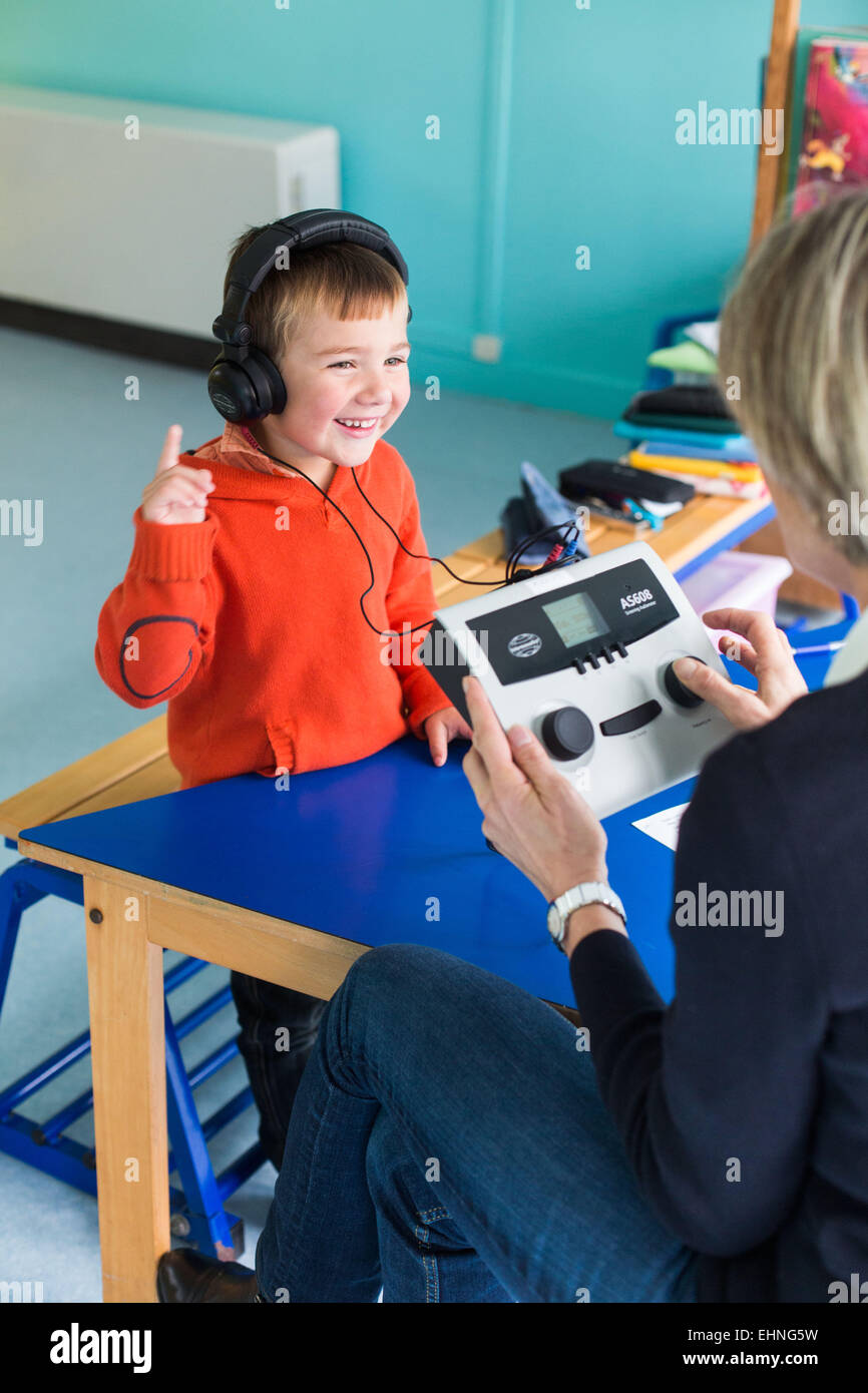 Medical check-up performed by a pediatric nurse of MCW in infant school, Charente, France. - Stock Image