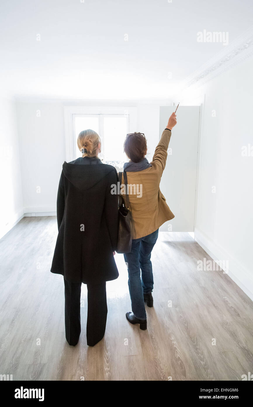 Woman with a real estate agent. - Stock Image