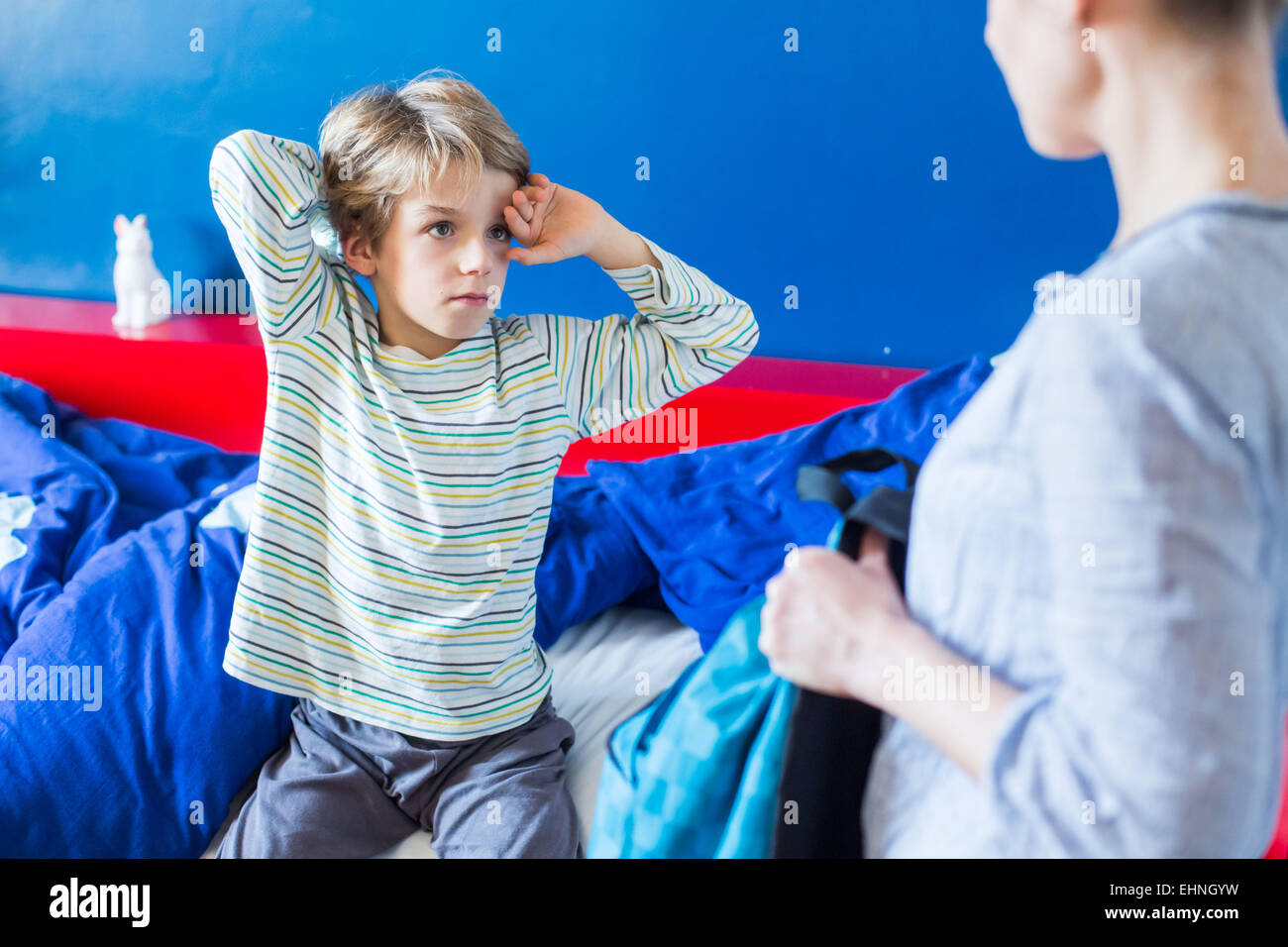 8 year old boy tired. - Stock Image