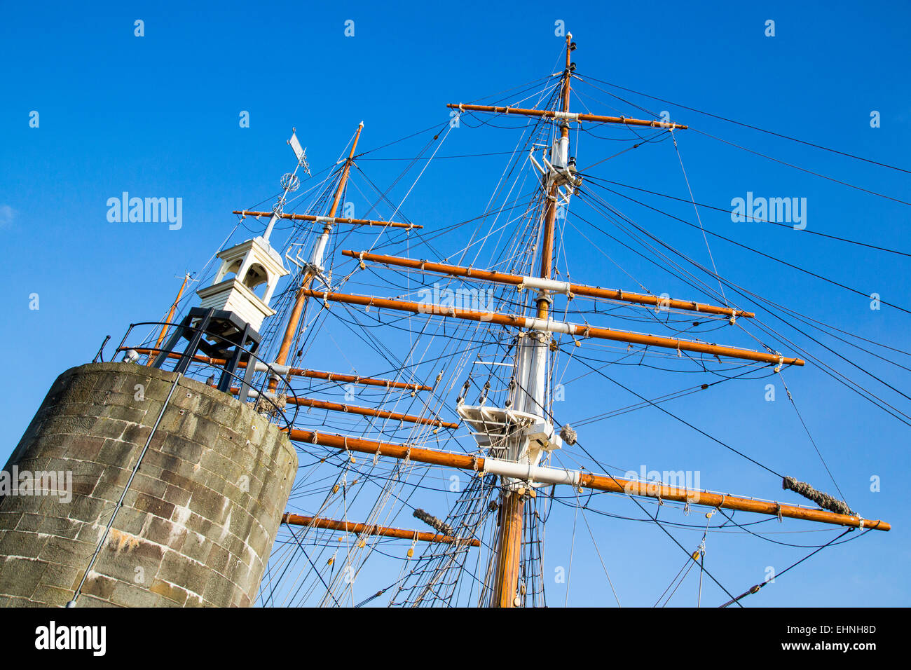 Masts and rigging of a tall sailing ship by the bell tower near the Lloyd's Building on Bristol's floating - Stock Image