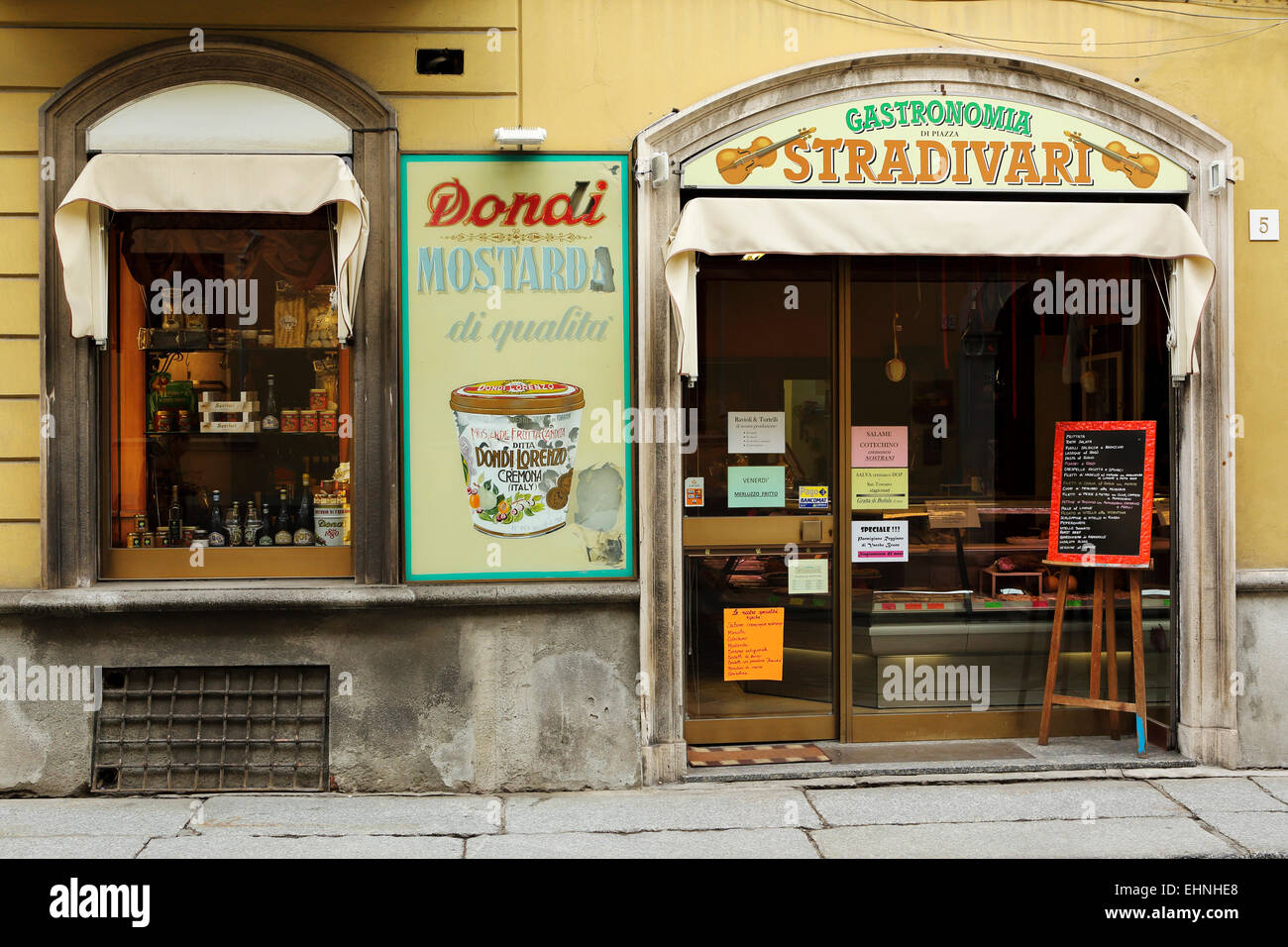 The facade of the Gastronomia Stradivari store in Cremona, Italy. The shop sells locally produced food and drink. - Stock Image