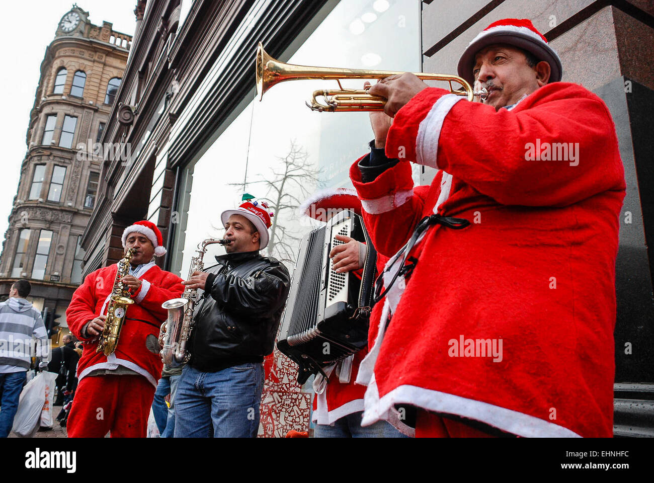 Play Christmas Music.Musicians Play Christmas Music On A Street In Belfast