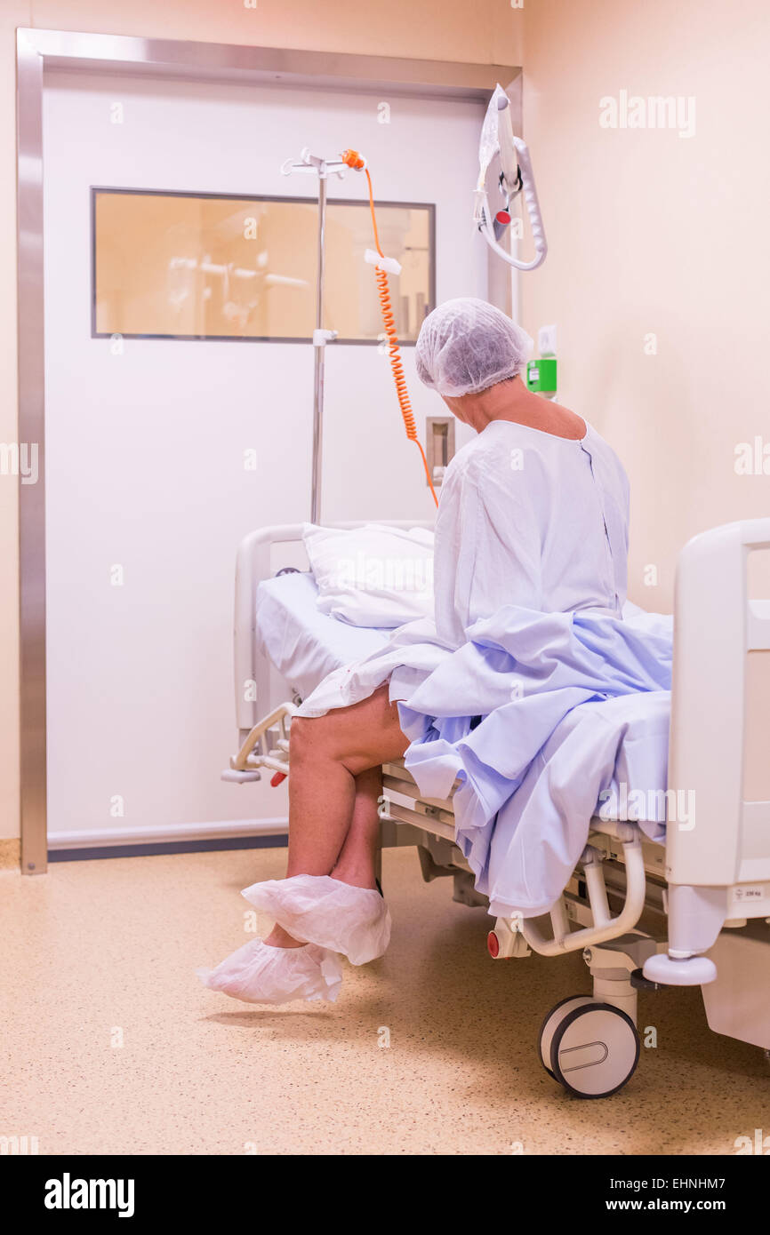 Patient woman before entering the operating room. - Stock Image