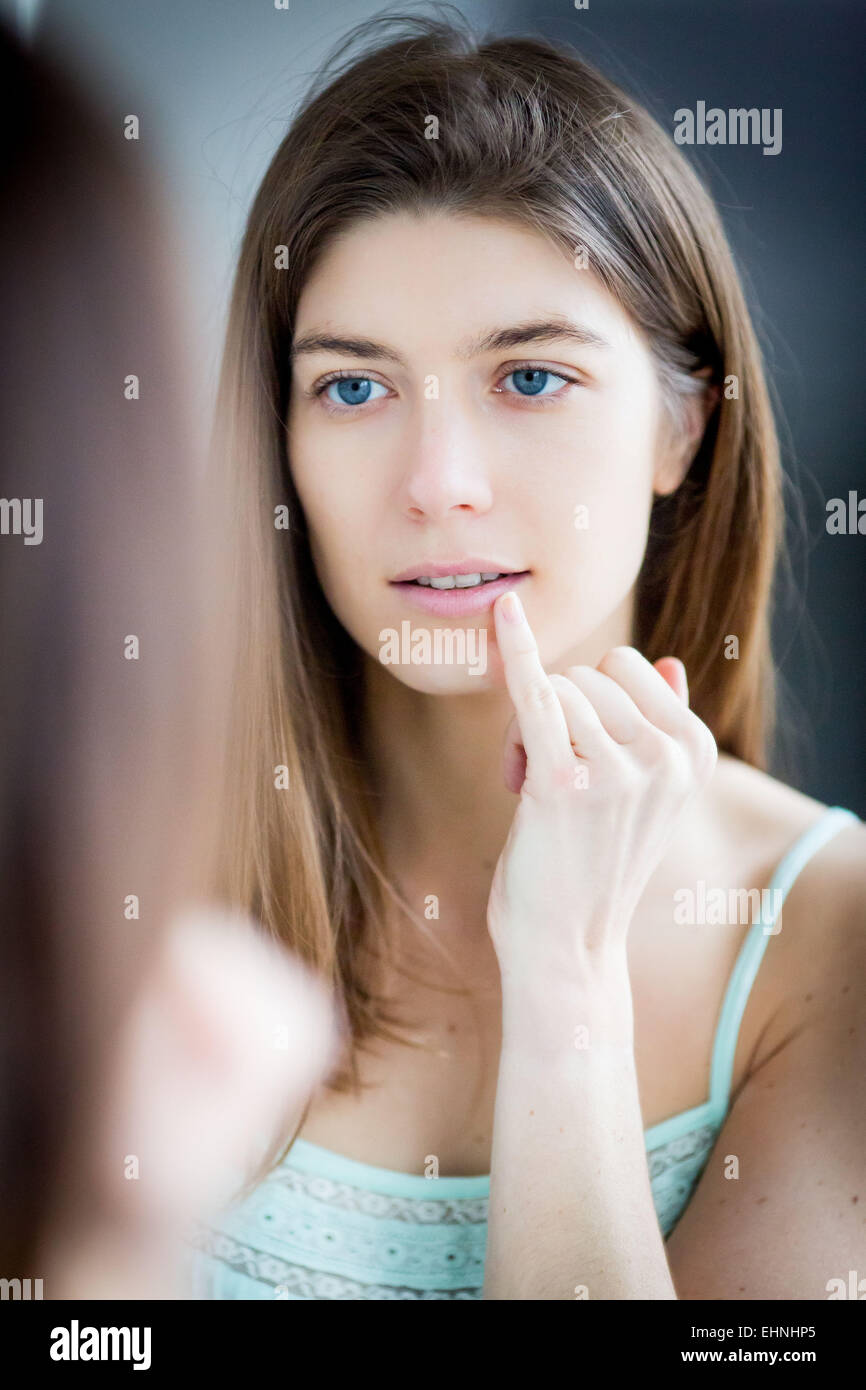 Woman with finger on lips. - Stock Image
