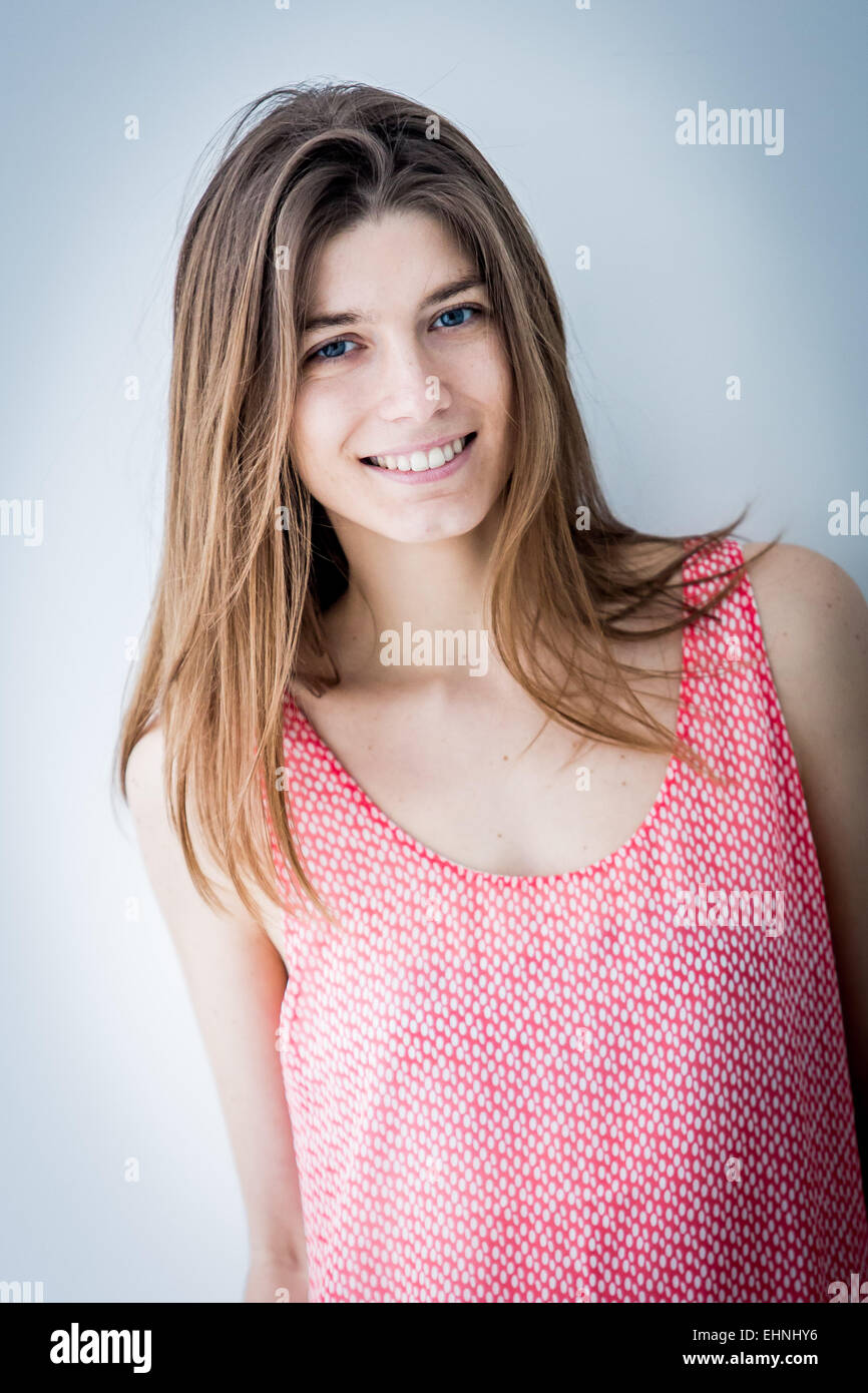 Portrait of smiling woman. - Stock Image