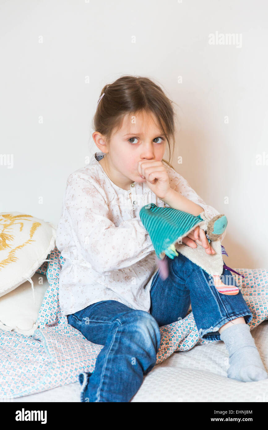 5 year-old girl sucking her thumb. - Stock Image