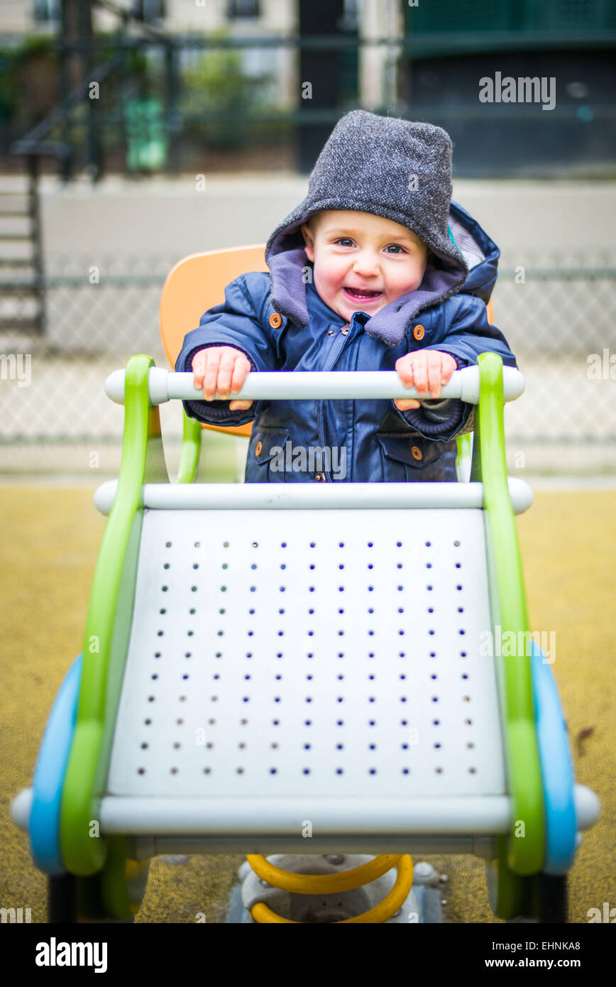 18 month-old baby boy in a playground. - Stock Image