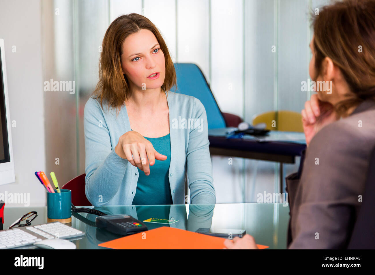 Doctor discussing with a female patient. - Stock Image