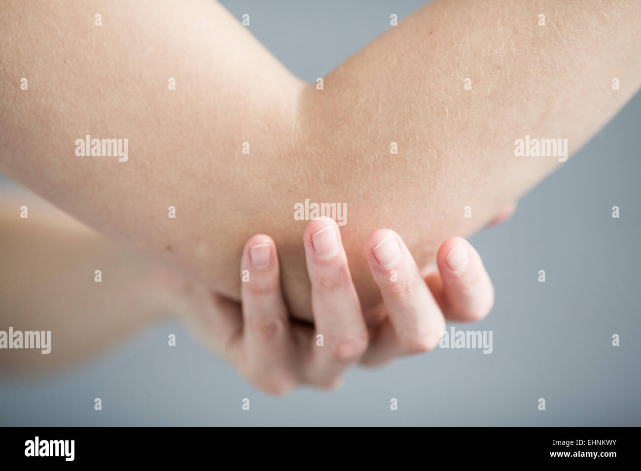 Woman elbow joint pain. - Stock Image
