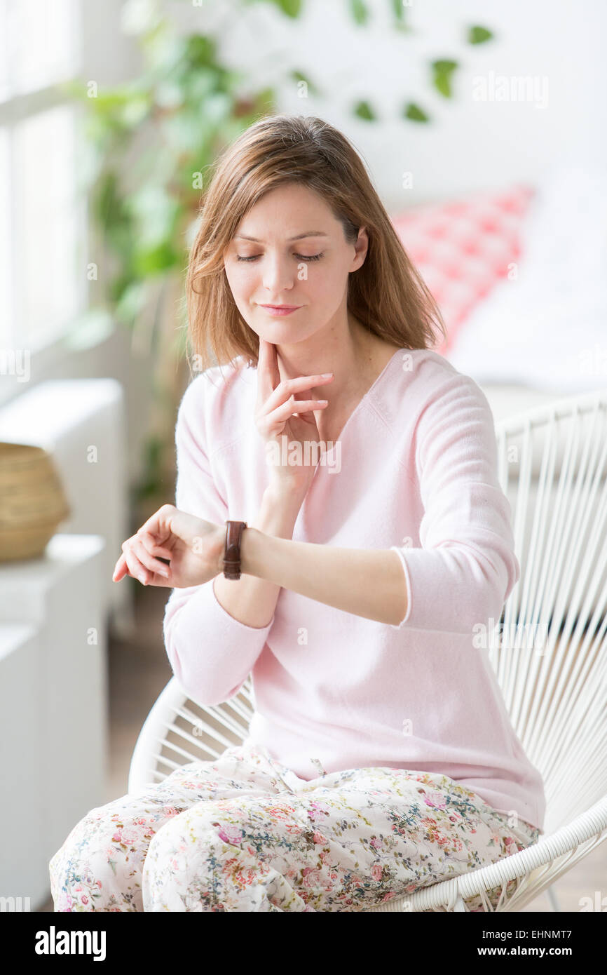 Woman checking pulse. - Stock Image