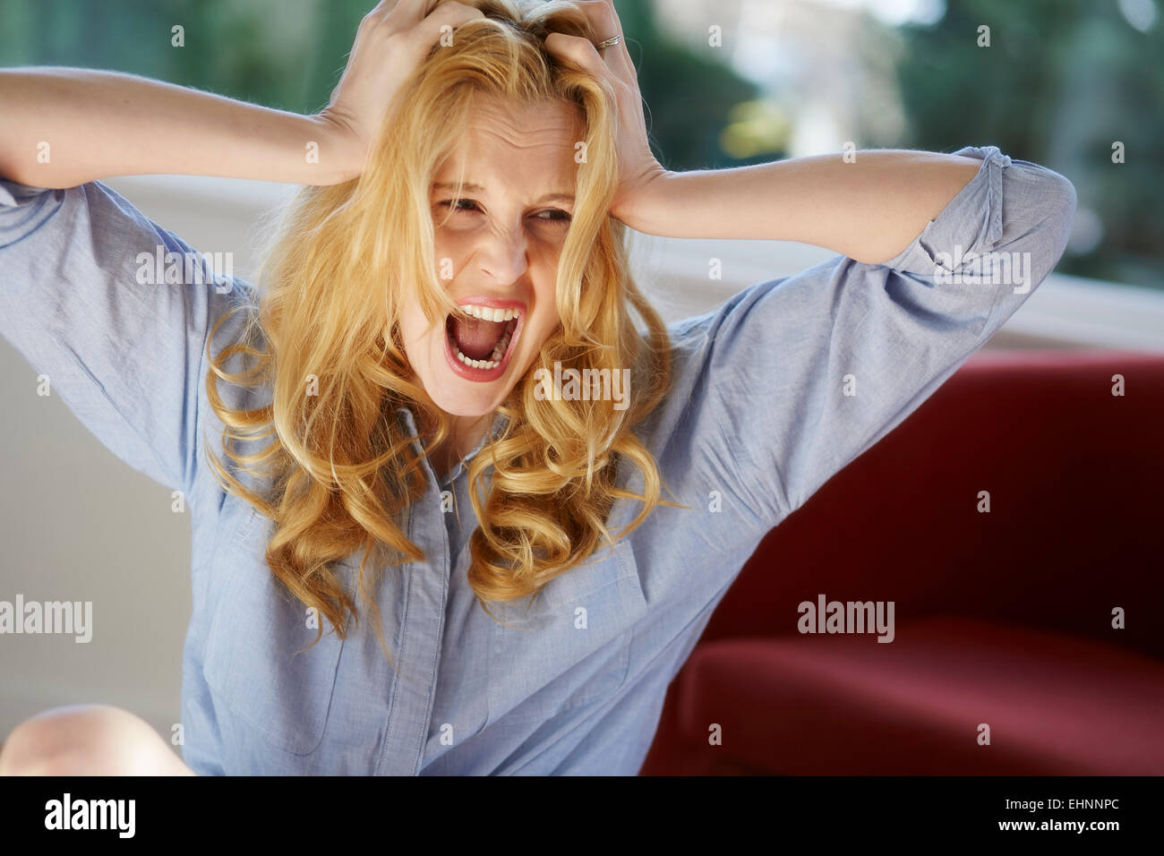 Woman screaming - Stock Image