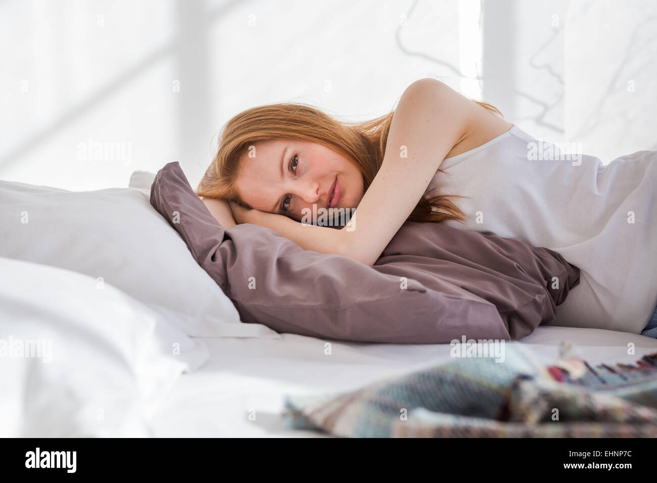 Woman resting bed. - Stock Image