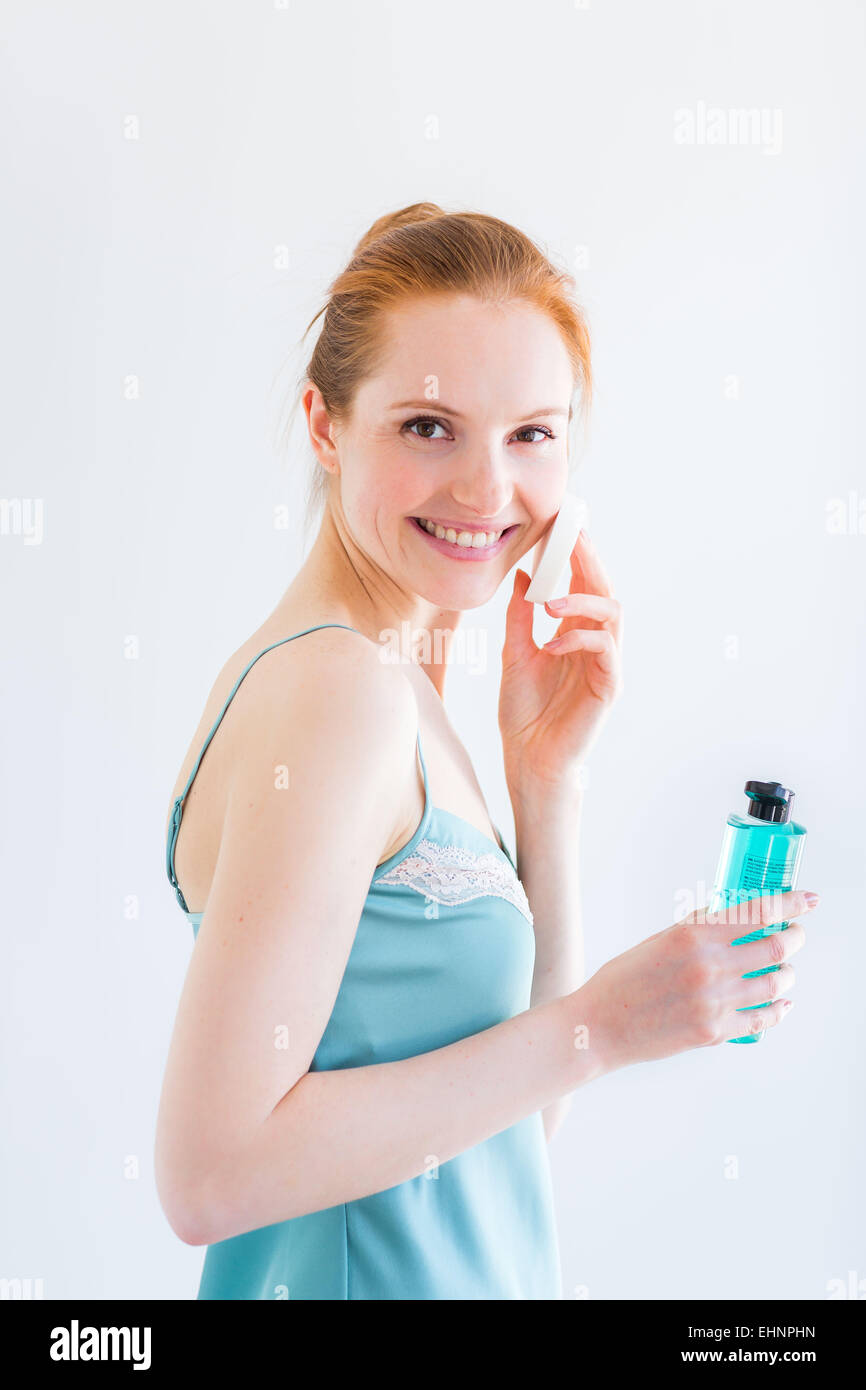 Woman removing make-up. - Stock Image