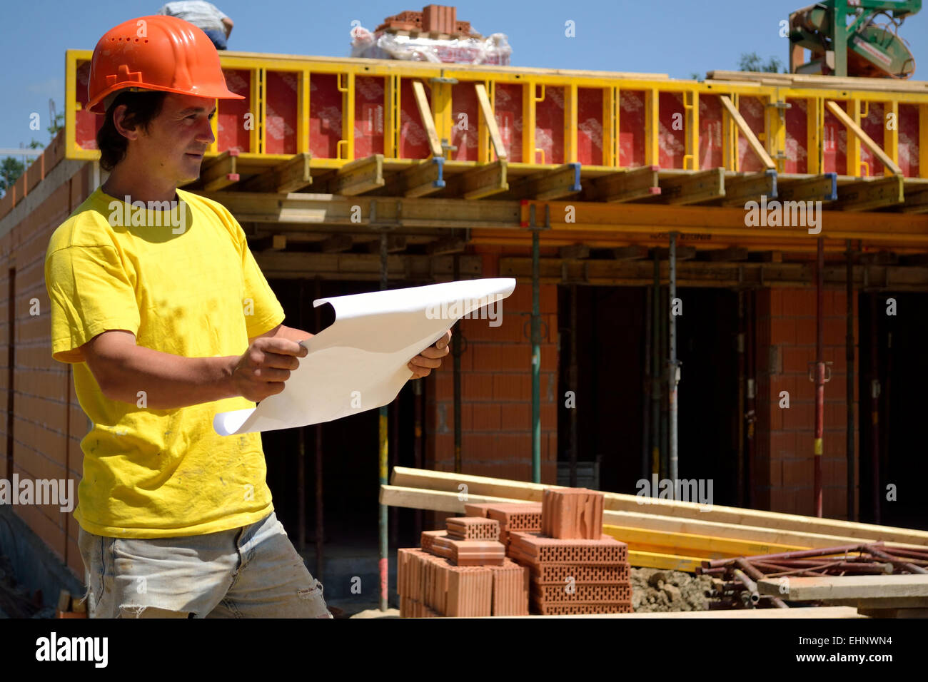 Construction foreman checks - Stock Image