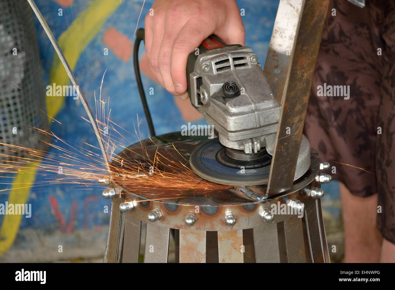 Sparks with an angle grinder - Stock Image