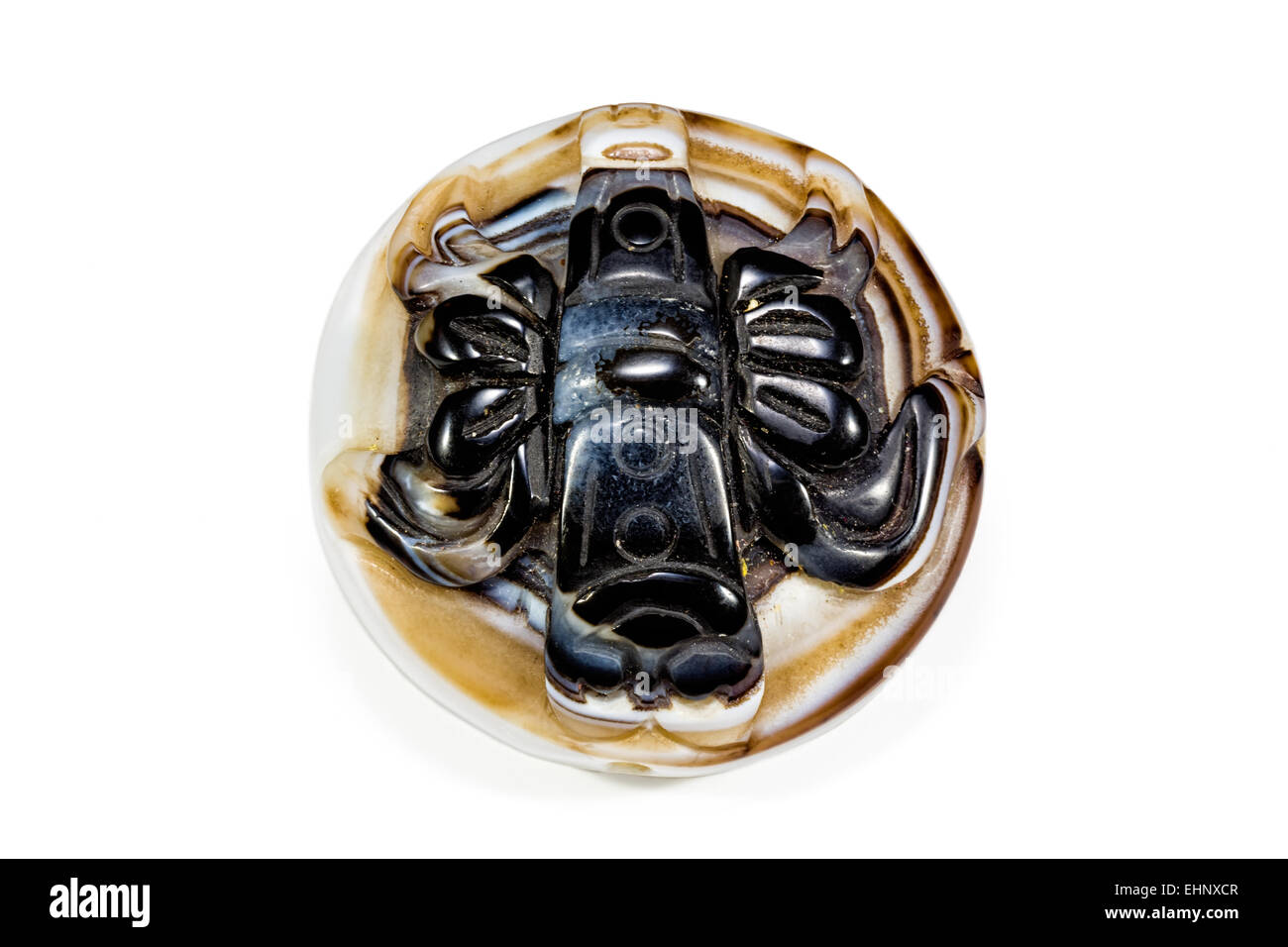 Banded Agate (Chalcedony- the compact micro-crystalline variety of quartz) stylised oriental carving obverse Crystal - Stock Image