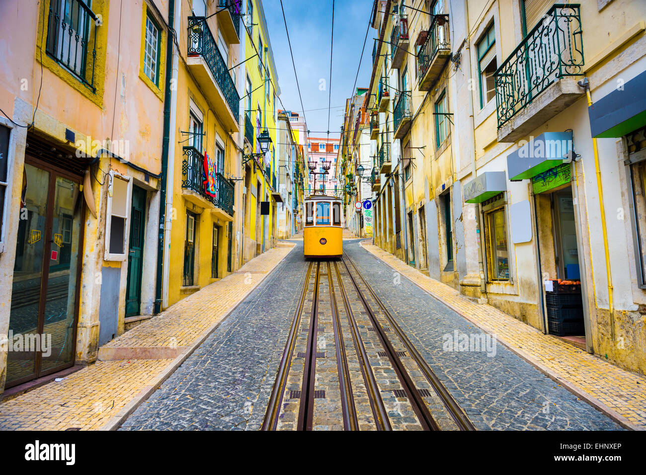 Lisbon, Portugal old town streets and street car. - Stock Image