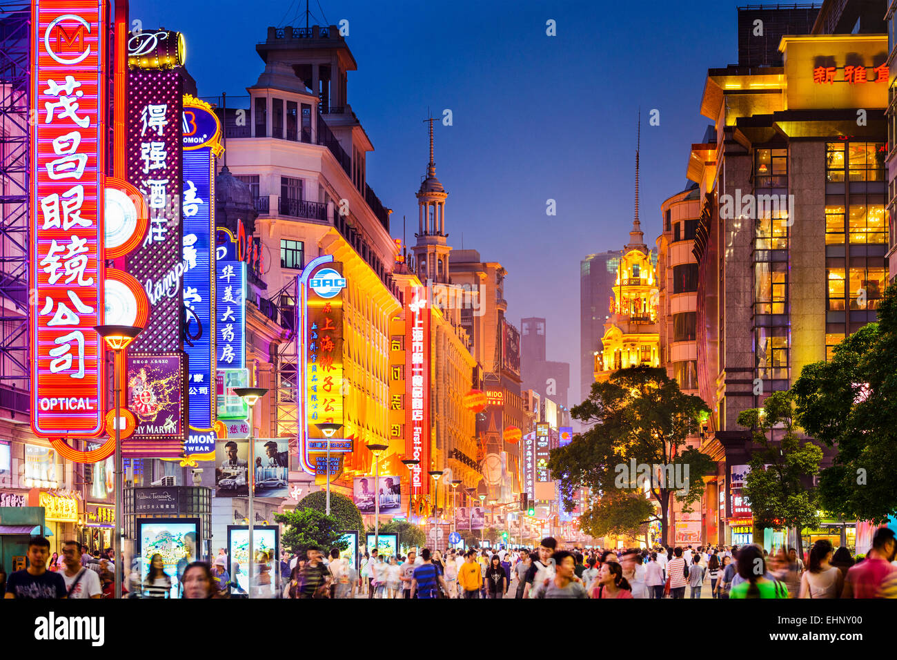 Neon signs lit on Nanjing Road in Shanghai, China. - Stock Image