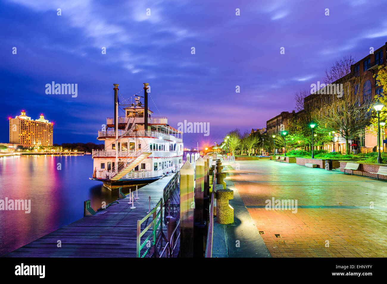 Savannah, Georgia, USA riverfront promenade at twilight. - Stock Image