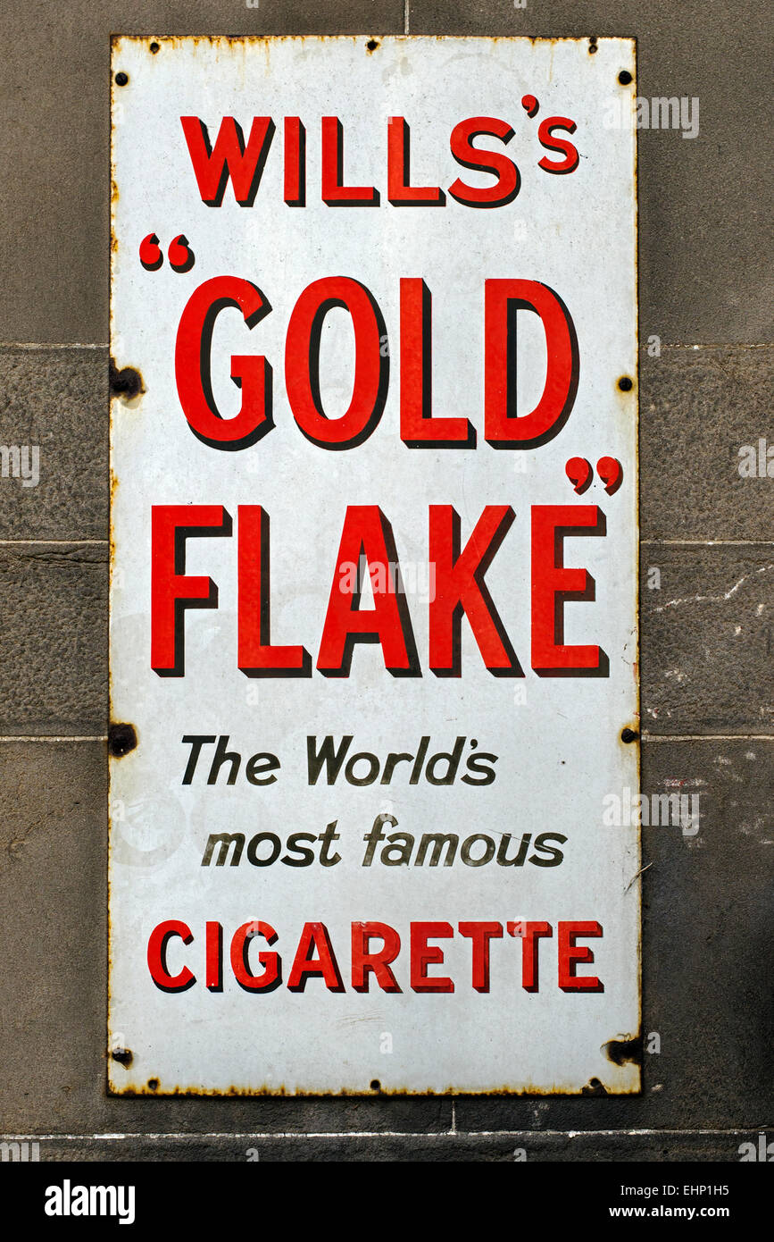 A metal advert for Will's Gold Flake cigarettes on the wall of a public house in Edinburgh. - Stock Image