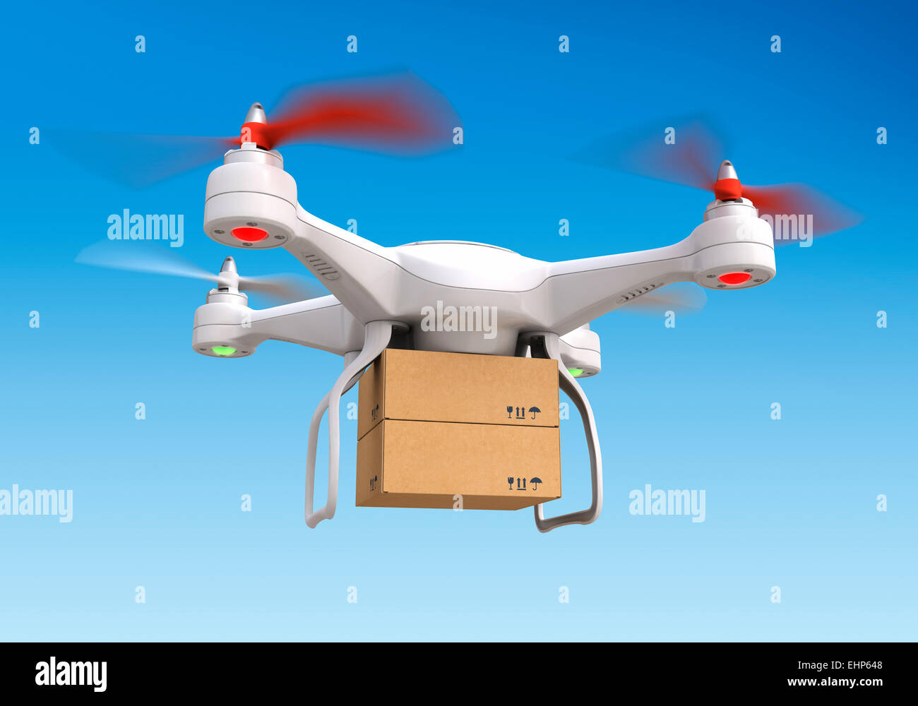 Quadrocopter drone  delivering package - Stock Image