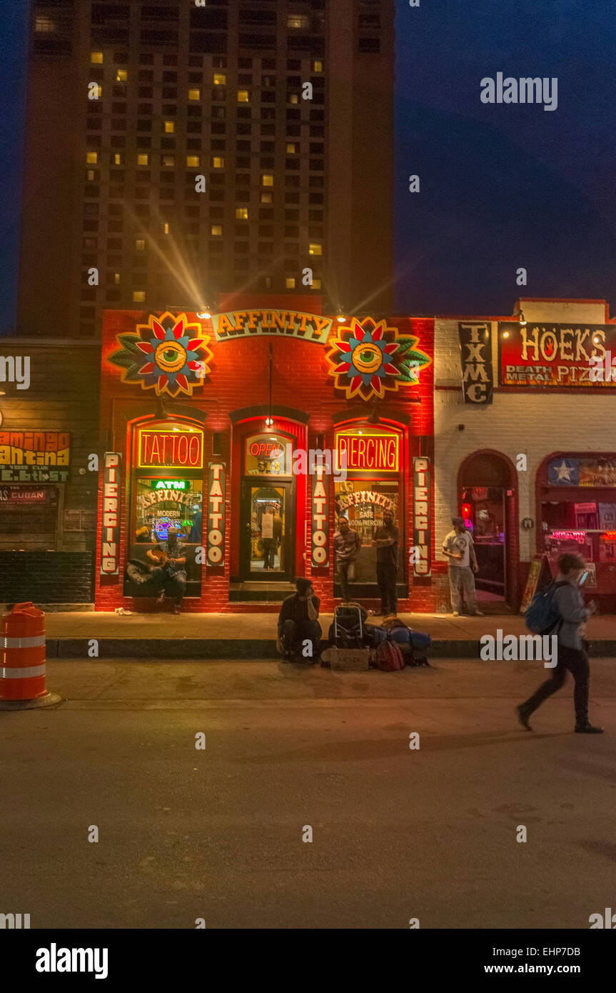 Austin, Texas. 15th Mar, 2015. One of the many tattoo shops on 6th ...