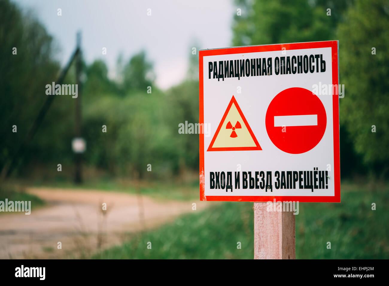 Ionizing Radiation sign next to village Belarus, Gomel region. Zone of Alienation - Stock Image