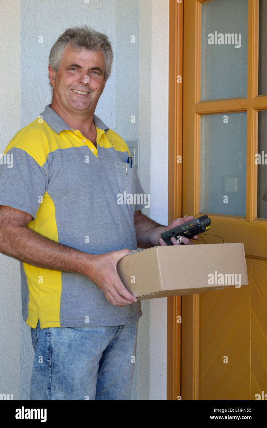 Postman delivers package Stock Photo