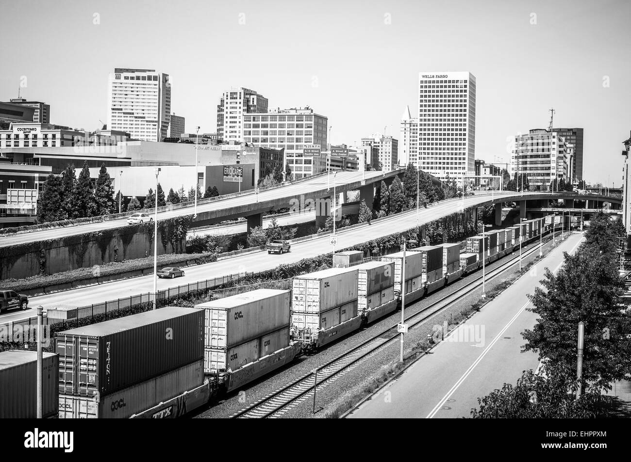 Timeless black and white image of transportation via railroad and roads in the USA. B&W - Stock Image