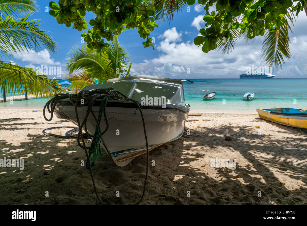 A boat tied up on Dravuni Island which is part of Fiji located in the south pacific. - Stock Image