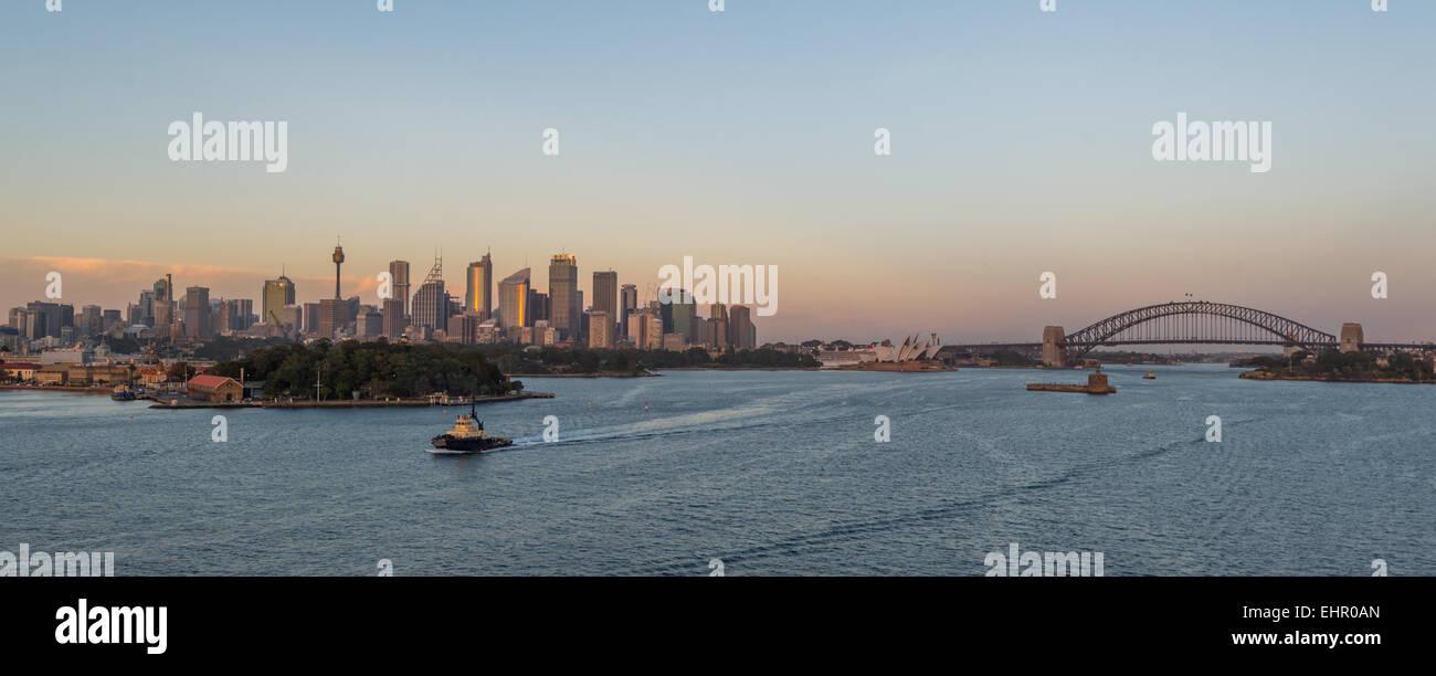 Cruising into Sydney harbour early morning during sunrise. Stock Photo