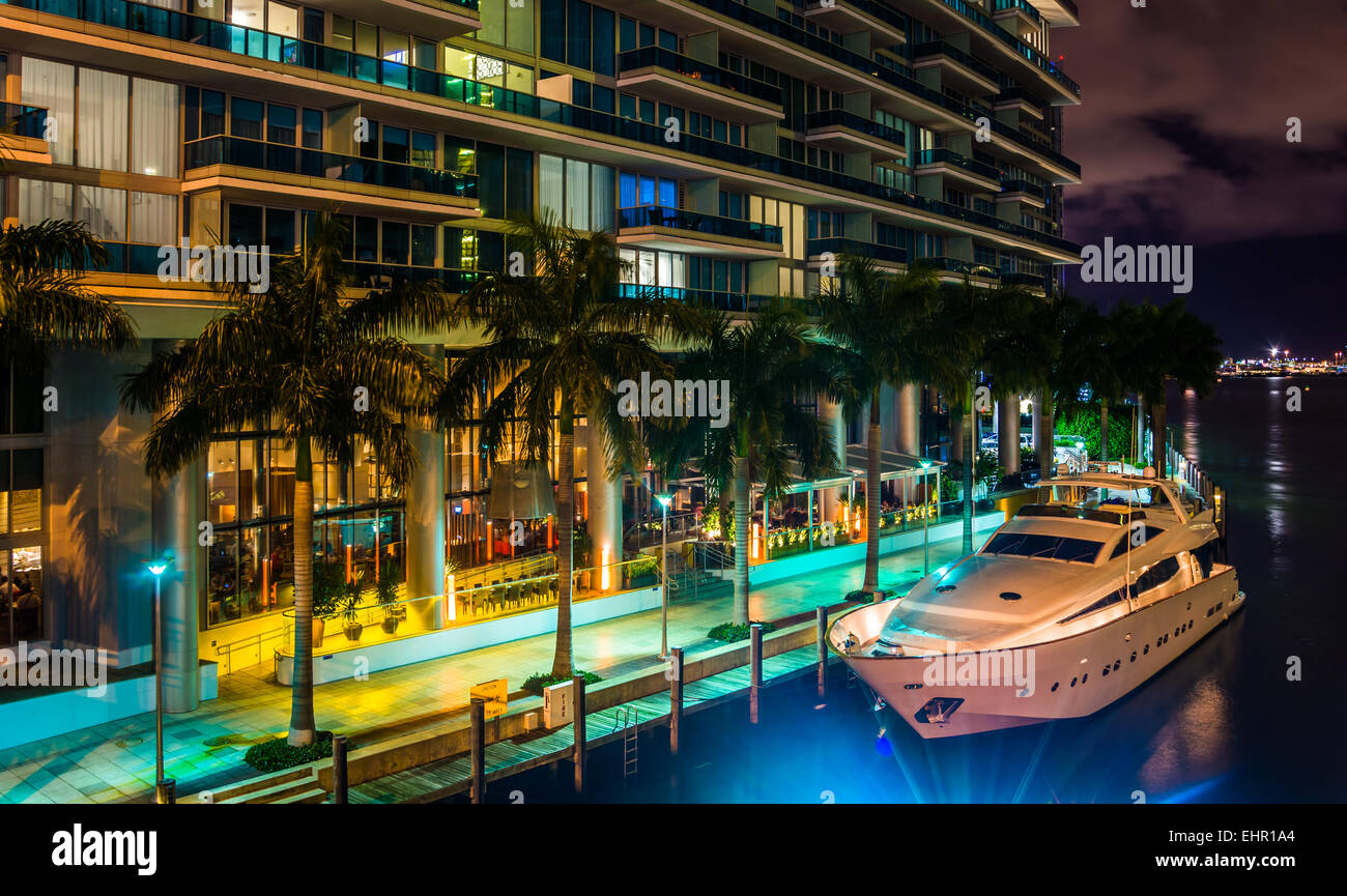 the epic hotel and a boat in the miami river at night in. Black Bedroom Furniture Sets. Home Design Ideas