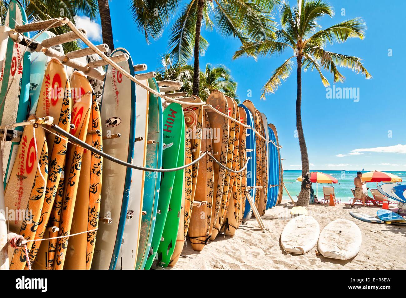 Honolulu, HI, USA - September 7, 2013: Surfboards lined up in the rack at famous Waikiki Beach in Honolulu. Oahu, - Stock Image