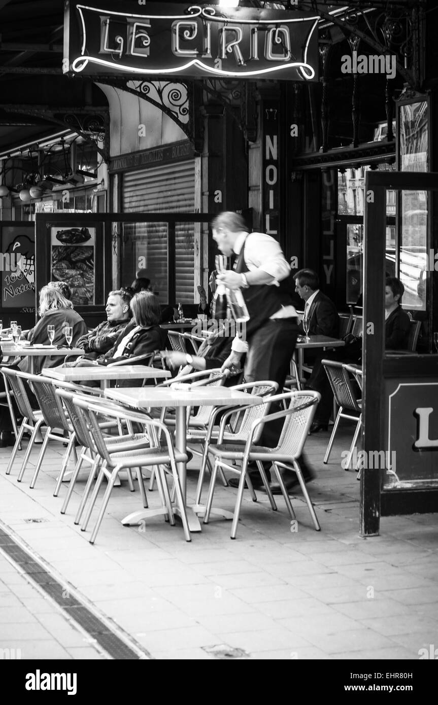 The Le Cirio sidewalk cafe in Brussels, Belgium. Timeless scene in black and white. - Stock Image