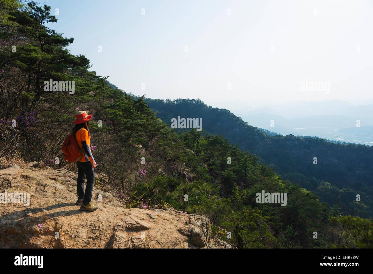 Asia, Republic of Korea, South Korea, Gyeongsangbuk-do, Gyeongju, hiker in Mt Namsan National Park, Unesco site - Stock Image
